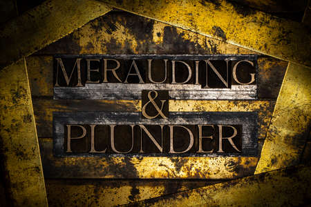 Merauding & Plunder text on vintage textured bronze grunge copper and gold background