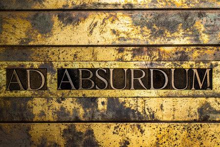 Ad Absurdum text on vintage textured bronze grunge copper and gold background