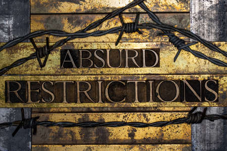 Absurd Restrictions text on vintage textured bronze grunge copper and gold background