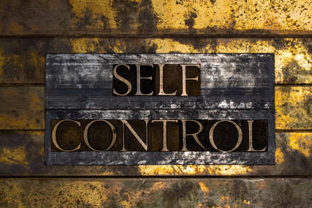 Self Control text on grunge textured copper and gold background Stock Photo