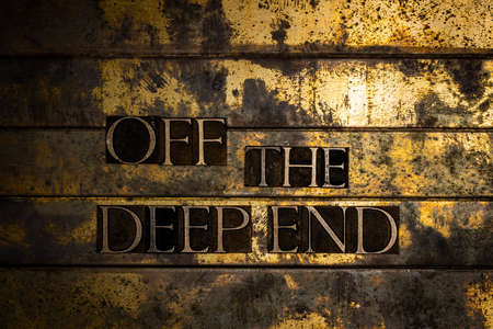 Off The Deep End text on vintage textured bronze grunge copper and gold background