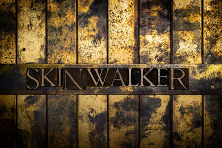Skinwalker text on grunge textured copper and gold background