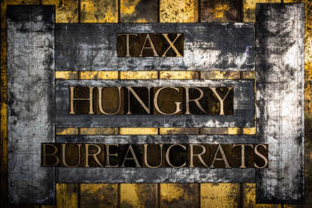 Tax Hungry Bureaucrats text on grunge textured copper and gold background