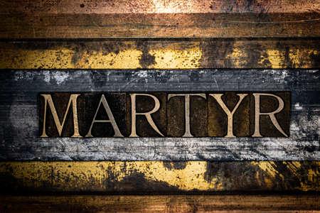 Martyr text on textured grunge silver and vintage copper background Standard-Bild