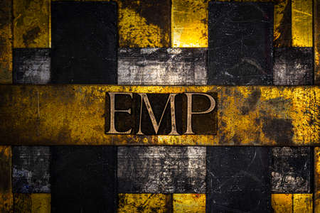 EMP text on vintage textured grunge copper and gold background Stock fotó