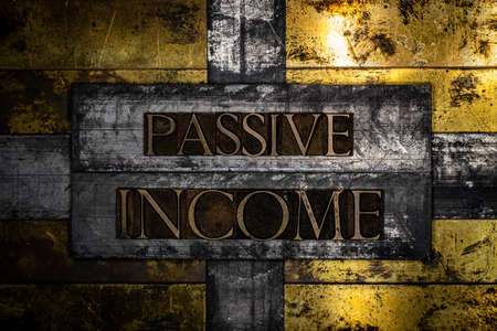 Passive Income text on grunge textured copper and gold steampunk style background