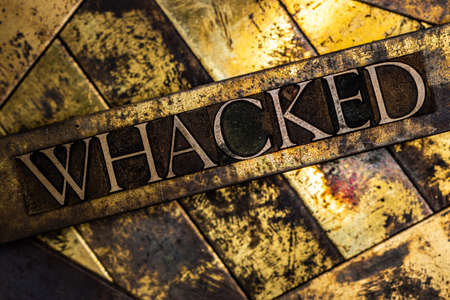 Whacked text on vintage textured grunge copper and gold background Stockfoto