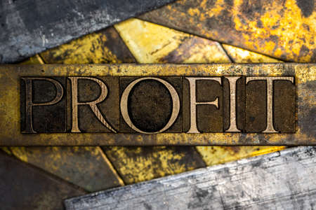 Profit text on textured grunge copper and vintage gold background Stockfoto