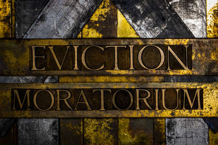 Eviction Moratorium text message on textured grunge copper and vintage gold background Stockfoto