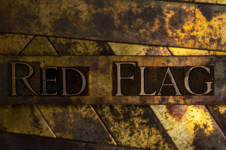 Red Flag text on vintage textured silver grunge copper and gold background