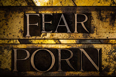 Fear Porn text formed with real authentic typeset letters on vintage textured silver grunge copper and gold background Stockfoto