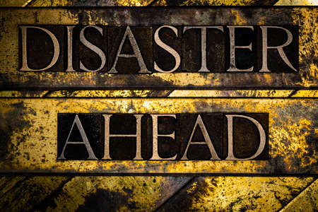 Disaster Ahead text on vintage textured grunge copper and gold steampunk background