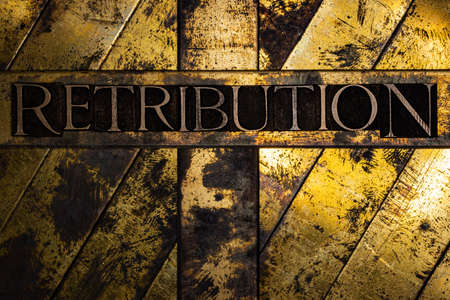 Retribution text on vintage textured silver grunge copper and gold background Stockfoto