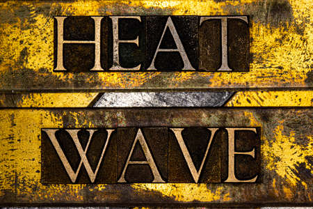 Heat Wave text on vintage grunge textured copper and gold background
