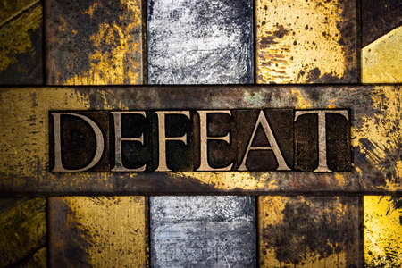 Defeat text message on vintage textured grunge copper and gold background