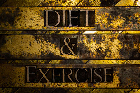 Diet and Exercise text on vintage textured grunge copper and gold background