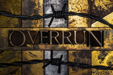 Overrun text message on textured grunge copper and vintage gold background with barbed wire Stockfoto