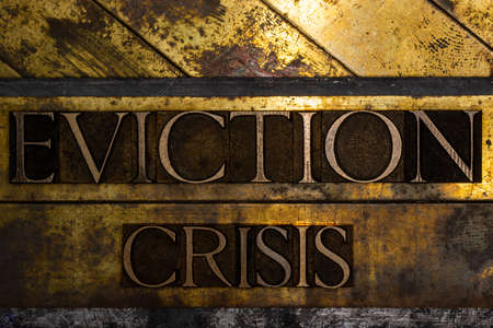 Eviction Crisis text message on textured grunge copper and vintage gold background