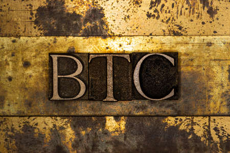 BTC text on textured grunge copper and vintage gold background Stockfoto