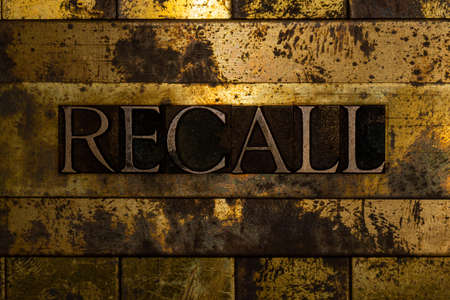 Recall text message on textured grunge copper and vintage gold background