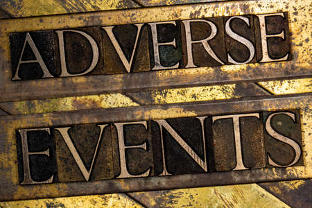 Adverse Events text on textured grunge copper and vintage gold background