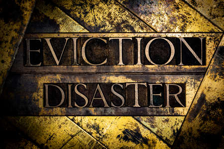 Eviction Disaster text message on textured grunge copper and vintage gold background Stockfoto