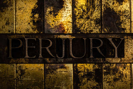 Perjury text message on textured grungy copper and gold background