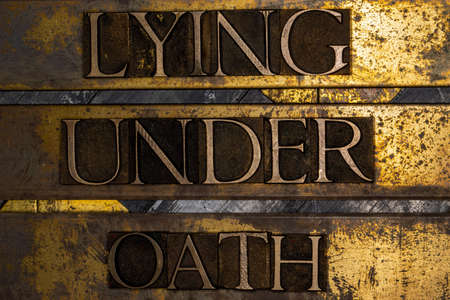 Lying Under Oath text message on textured grungy copper and gold background Stockfoto