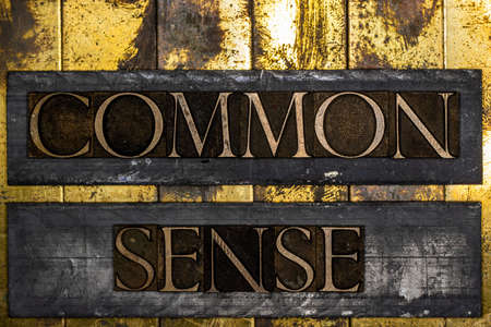 Common Sense text message on textured grunge copper and vintage gold background