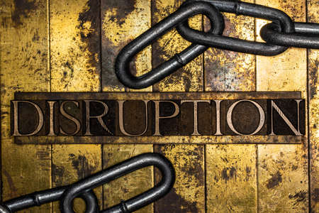 Disruption text with steel chain on vintage textured grunge copper and gold background