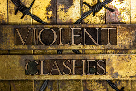 Violent Clashes text message on textured grunge copper and vintage gold background with barbed wire