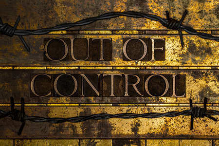 Out of Control text on textured grunge copper and vintage gold background