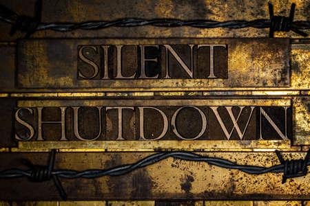 Silent Shutdown text on textured grunge copper and vintage gold background