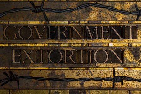 Government Extortion text on textured grunge copper and vintage gold background