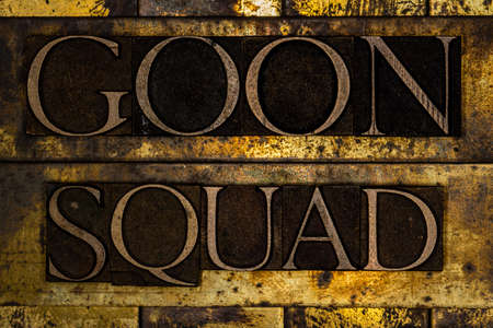 Goon Squad text on textured grunge copper and vintage gold background