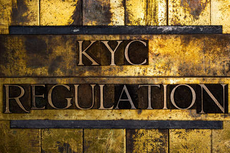 KYC Regulation text on textured grunge copper and vintage gold background