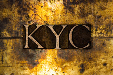KYC text on textured grunge copper and vintage gold background Stockfoto