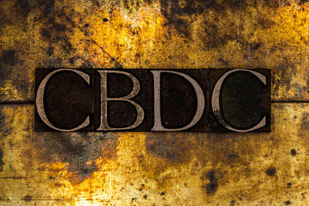 CBDC text on textured grunge copper and vintage gold background Stockfoto