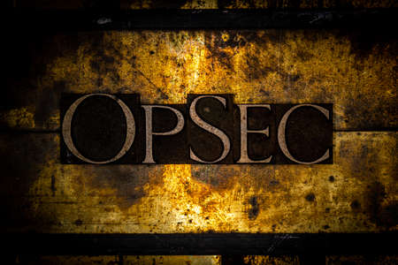 OpSec text on textured grunge copper and vintage gold background