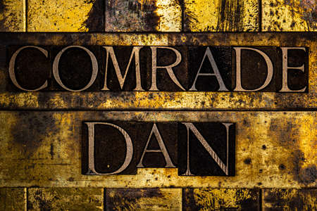 Comrade Dan text on textured grunge copper and vintage gold background