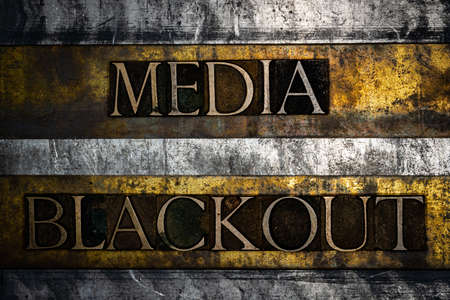 Media Blackout text on vintage textured grunge copper and gold background