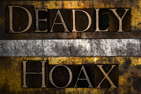Deadly Hoax text on textured grunge copper and vintage gold background Stockfoto