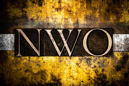 NWO text on textured grunge copper and vintage gold background Stockfoto