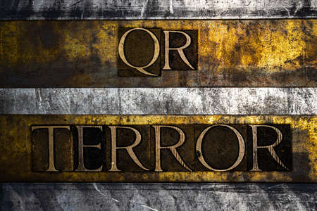 QR Terror text on textured grunge copper and vintage gold background