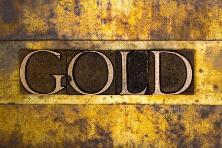Gold text on textured grunge copper and vintage gold background Stockfoto