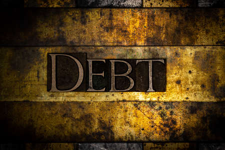 Debt text on textured grunge copper and vintage gold background Stockfoto