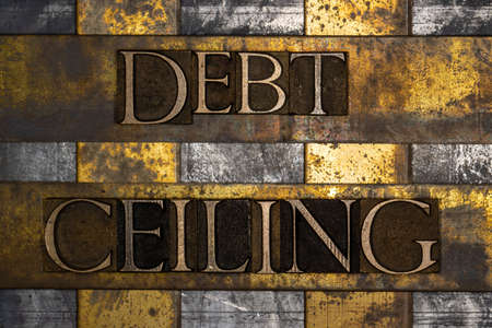 Debt Ceiling text on textured grunge copper and vintage gold background Stockfoto
