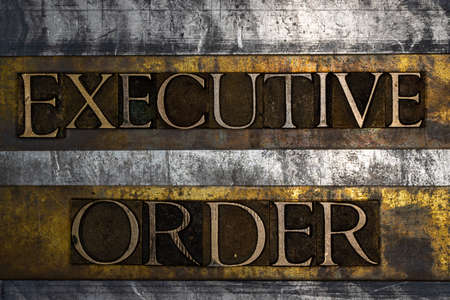 Executive Order text on textured grunge copper and vintage gold background