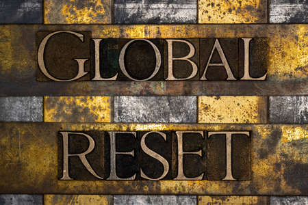 Global Reset text on textured grunge copper and vintage gold background