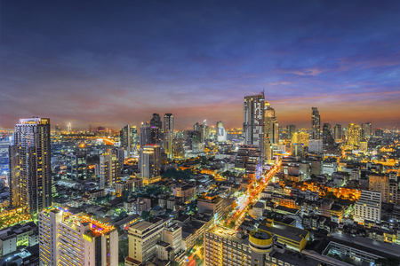 Aerial view of Bangkok modern office buildings, condominium, living place in Bangkok city downtown with sunset scenery, Bangkok , Thailand Stock Photo